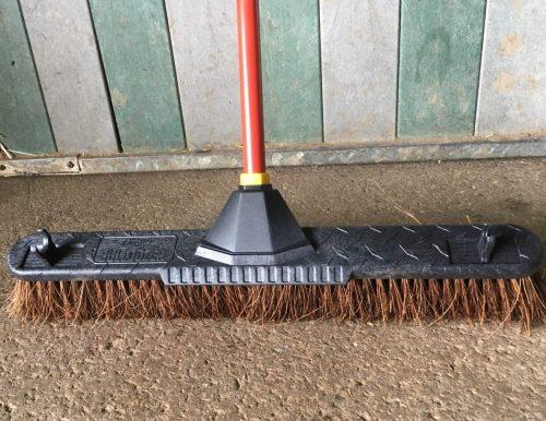 yard broom outside stable