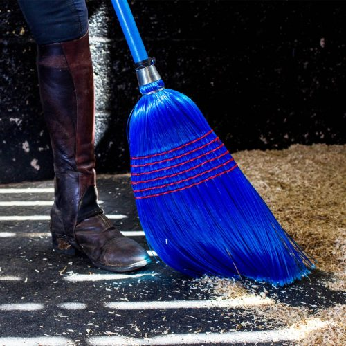 blue corn broom with shavings
