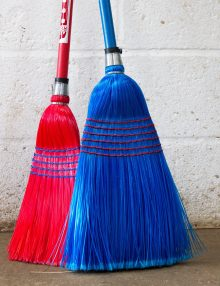red and blue corn brooms
